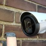 Axis P1435-LE Network Surveillance camera installed on a brick wall